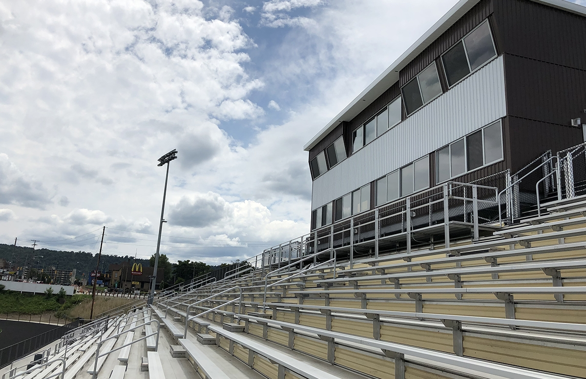 Aluminum bleachers featuring a press box