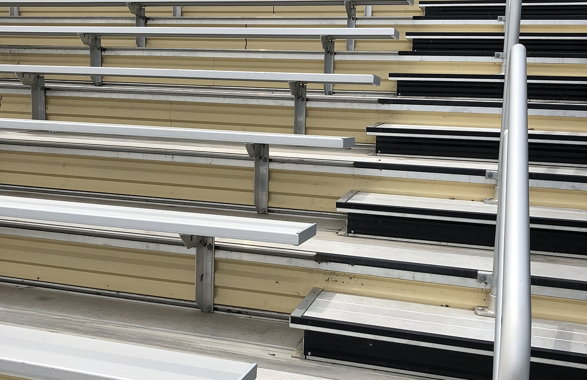 Aluminum bleacher seating featuring stairs with rails